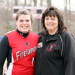Firelands High School varsity softball head coach Judy Dostall, right, will be stepping down after 19 years as head coach at the end of this season so she can watch her daughter, Samantha Do …