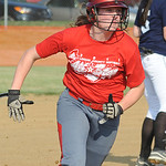 Red All Star Patty Davis scores in third inning of Lorain County All Star softball June 11.   Steve Manheim