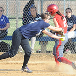 Blue All Star Megan Smith tags out Red All Star 2 Marie Masters at first base on June 11.   Steve Manheim