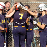 North Ridgeville's #7 Kailey Demarco is congratulated by teammates after hitting a home run.