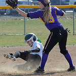Amherst's Lauren Farley slides in safely with a double as Avon's Alexis Dill catches the throw. STEVE MANHEIM/CHRONICLE