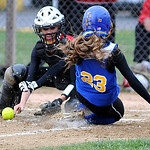 Clearview's Casey Jasinski slides safely home as Firelands catcher Nicole Rainey tries to tag her. KRISTIN BAUER | CHRONICLE