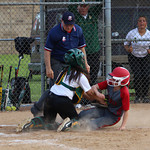 Elyria's Veronica Zack is tagged out at home by Amherst catcher Brooklynn Gonzalez. CHRISTY LEGEZA/CHRONICLE