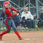 Elyria's Anna Daly hits a two-run RBI single in the second inning. STEVE MANHEIM/CHRONICLE