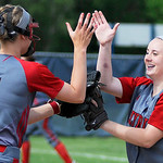 Elyria Elizabeth Ellis and short stop Carly Bachna celebrate a strike out. KRISTIN BAUER | CHRONICLE