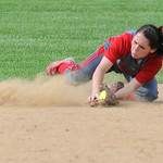 Elyria's Mackenzie Phares dives to catch a ball against Midview. KRISTIN BAUER | CHRONICLE
