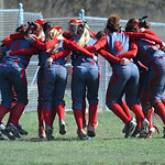 Elyria's softball team prepares for its game against St. Joseph's. KRISTIN BAUER/CHRONICLE