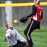 Firelands left fielder Sam Hribal tosses the ball to teammate Cass Kowalski after falling in the fifth inning against Black River. AARON JOSEFCZYK / CHRONICLE
