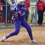 Keystone senior DH Nicole Neri connects on the first home run of her high school career Saturday in a 13-1 win over Bishop Hartley. The 'Cats also beat Mentor 11-1.