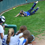 Midview catcher Cassie Haight throws off her face mask and attempts to dive for a ball hit behind the batters' box. KRISTIN BAUER | CHRONICLE