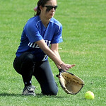 Midview center fielder Morgan Hamker scoops up a ground ball hit into the outfield. KRISTIN BAUER | CHRONICLE