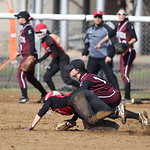Elyria's Alex Dick is tagged out at second while teammate Madison Fullmer makes a break for home.  RAY RIEDEL/CHRONICLE