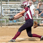 Wellington's #5 Erin Reisinger gets a hit. Columbia's catcher is #10 Sarah Viccarone.