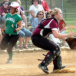 Columbia's #4 Emma Sullivan runs past Wellington's catcher, #21 Regan Mortoret, as she waits for the ball.