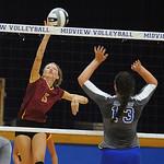 Avon Lake's Emily Schillinger hits over Midview's Paige Surman. STEVE MANHEIM/CHRONICLE