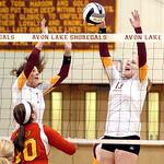 "Avon Lake's #3 Lauren Bakaitis and #13 Isabelle Wagner block Brecksville's #10 Dani D""Anna."