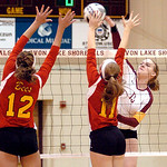 "Avon Lake's #13 Isabelle Wagner spikes the ball past Brecksville's #12 Emily Sokolowski and #11 Nikki D""Anna."