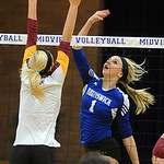 Brunswick 1 Ally Badowski hits over Avon Lake Katie Mihalik in Div. I district final at Midview Oct. 25.  Steve Manheim