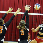 Brookside Tyller Holley hits over Buckeye 3 Jessica Hoshaw and 13 Megan Mercurio Sep. 13.  Steve Manheim
