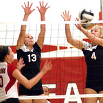 Brookside's #13 Kady Whitsel and #4 Tyller Holey block Firelands' #10's Casey Morrissette.