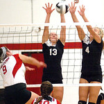 Brookside's #13 Kady Whitsel and #4 Tyller Holley block Firelands' #9 Maison Mastellone's.