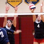 Brookside's #1 Celina Rock and #4 Tyller Holley block Lorain's #7 Marlena Guice's spike.