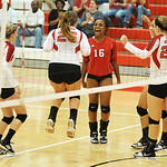 Elyria celebrates scoring a point against Stow on Tuesday.  KRISTIN BAUER | CHRONICLE