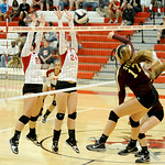 Elyria's Rachel Holliday and Abigail Elek block Stow's Jessica Guider hit. KRISTIN BAUER | CHRONICLE
