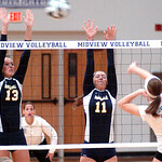 North Ridgeville's #13 Maddie Schauer and #11 leap to block Midview's #2 Al Stanziano's spike.