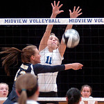 Midview's #11 Cassie Height leaps to block North Ridgeville's #13 Maddie Schauer's ball