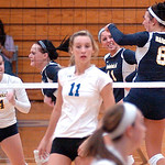 North Ridgeville's #8 Jessica Lentz jumps for joy as her teammates celebrate winning a point.