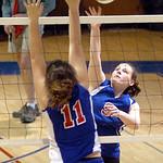 Open Door's #9 Lauren Turner spikes the ball past First Baptist's #11 Morgan Niemier.