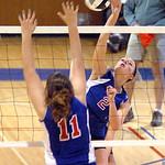 Open Door's #2 Brooke Camera spikes the ball past First Baptist's #11 Morgan Niemier.