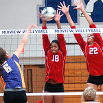 Elyria's #18 Danya Corlew and #22 Alexis Middlebrooks block Avon's #6 Liz Zollos' spike.