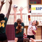 Avon Lake's Lauren Bakaitis tries to spike the ball past Amherst's Brooke Wallace and Riley Schenk.  LINDA MURPHY/CHRONICLE