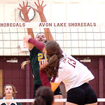 Avon Lake's Bethany Tober spikes the ball past Amherst's Mallory Sliman.  LINDA MURPHY/CHRONICLE