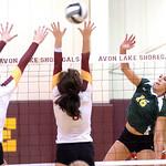 Amherst's Ashley Makruski pops the ball past Avon Lake's Katie Coughlin and Alaina Sliwinski.  LINDA MURPHY/CHRONICLE