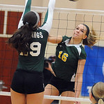 Amherst's Ashley Makruski hits past Strongsville's Hannah Mott. STEVE MANHEIM/CHRONICLE