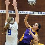 Avon Brianna Conroy hits above Midview 9 Becca Mullins Oct. 14.  Steve Manheim