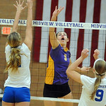 Avon 5 Brianna Conroy hits over Midview Cassie Haight, left, and Becca Mullins in sectional Oct. 14.  Steve Manheim