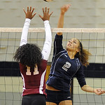 Lorain's Destiny Wilson hits over Maple Heights' Ebony Harris.  Steve Manheim