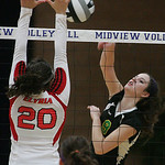 Amherst's No. 9 Erica Turner and EHS's No. 20 Haley Looney.     photo by Chuck Humel