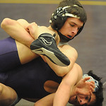 Clearview's Markus Cruz, top, defeats Avon's Austin Matska in the 126 weight class. STEVE MANHEIM/CHRONICLE