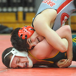 Amherst's Seth Orcutt loses to Brecksville's Austin Hiles in the 132-pound weight class. STEVE MANHEIM/CHRONICLE
