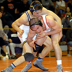 Olmsted Falls' Mike Hansinger beat Elyria's Jt Brown in the 170-pound championship match. LINDA MURPHY/CHRONICLE