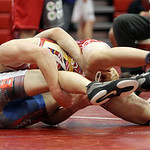 Wadsworth's Noah Baughmon wrestles Cody Sergent in the 113-pound final yesterday during the state wrestling tournament at Elyria High School. (CT photo by Anna Norris.)