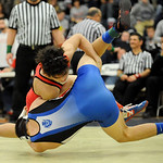 Elyria's Mikah Price scores a takedown against Brunswick's Christian Camacho in the first period of the 138 pound championship match. JUDD SMERGLIA/CHRONICLE