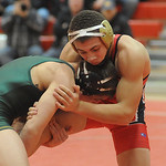 Elyria's Darrion Overall against Oregon Clay in the 145 weight class in dual finals. STEVE MANHEIM/CHRONICLE