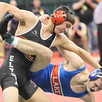 Ben Darmstadt, left, of Elyria looks for a takedown against Andrew McNally of Uniontown Lake in a 152-pound semifinal. DAVID RICHARD / CHRONICLE