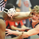 Mike Repko, right, of Vermilion is hit in the face by Mifflin's Hannibal Tate in a 152-pound match. DAVID RICHARD / CHRONICLE